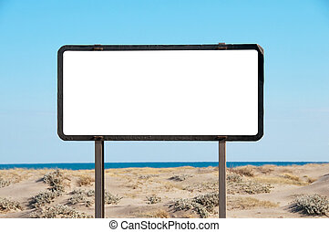 White billboard on the beach, blue sky, copy-space