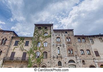 Piazza delle Erbe in San Gimignano, Italy - Piazza delle...