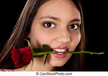 Woman with red rose in her mouth