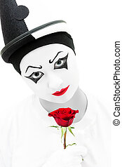 Sad clown with red rose - Unhappy Pierrot in high key black...