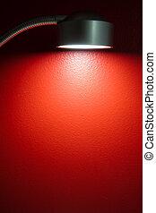 lamp illuminating red wall