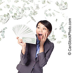 business woman look handful of money with money rain, asian...