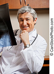 Happy Radiologist With X-ray - Portrait of happy mature male...