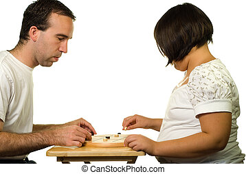 Tic-tac-toe - Father and daughter playing a game of...