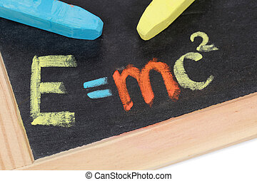Einsteins formula - The formula E=mc2 on a blackboard at...