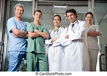 Medical Professionals Standing With Hands Folded - Portrait...
