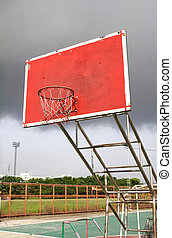 old outdoor basketball hoop agains