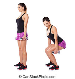 Young woman working out with barbells - Young woman working...