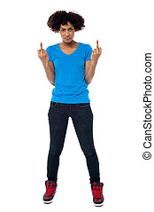 Annoyed young female showing middle finger - Studio shot of...