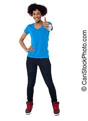 Joyous young woman gesturing success