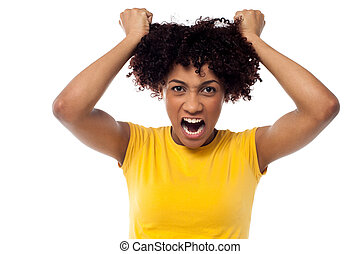 Angry young woman pulling her hair out - Irritated woman...
