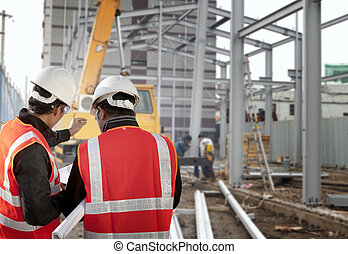 construction worker - two foreman discussion on construction...