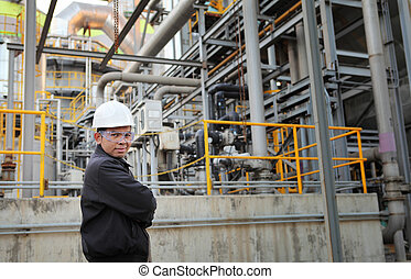 engineer oil refinery - engineer standing beside pipeline...
