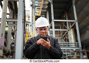 engineer oil refinery communicate via mobile phone