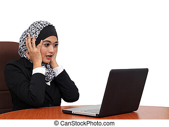 beautiful muslim business woman scared, terrified sitting at...