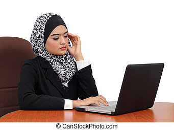 Headache and Stress at work Young professional muslim woman...