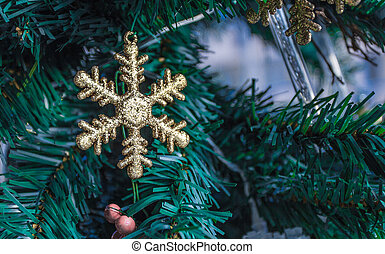 The snowflake - Snowflake hung on the Christmas tree in the...