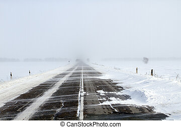 Snowing Road - Snowing road in the middle of snow fields