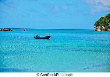 Boat in Turquoise and Blue Water - Boat in the Caribbean Sea...