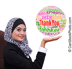 young muslim business woman showing Thank you word globe in...