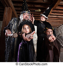 Halloween Wizard Family - Cute family of people dressed in...