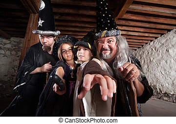 Mythical Family of Wizards - Father and children in mythical...