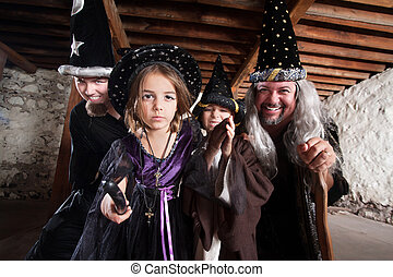 Spell Casting Family - Magician father and children casting...