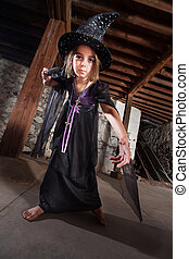 Young Witch Pointing Her Staff - Serious female European...
