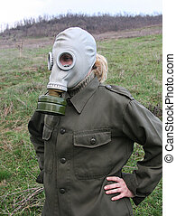 Girl with gas mask outdoor