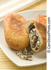 Patty stuffed with mushrooms and eggs