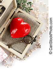 red heart with key in box isolated on white background