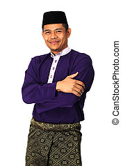 Asian muslim male in traditional Malay costume, Baju Melayu