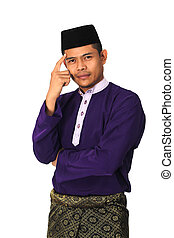 Asian muslim male with traditional Malay costume in thinking...