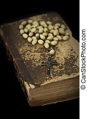Ancient book with prayer beads