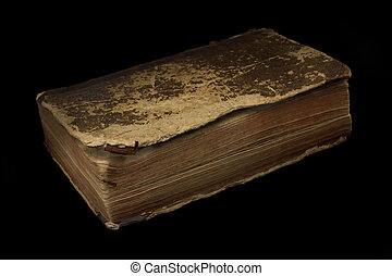 Ancient worn off book on black background