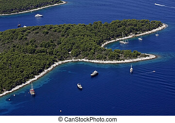 Bays with boats and yachts on island Hvar from air