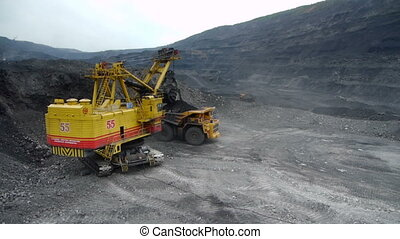 Mining dump trucks in the open pit mine, heavy truck in coal...