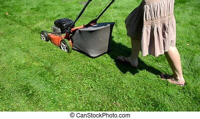 woman skirt cut grass - walk woman girl in skirt and...