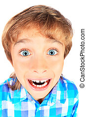 grimace - Portrait of a funny emotional 9 year boy. Isolated...