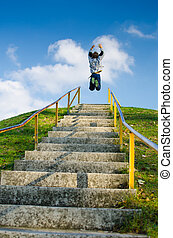 Achieving Target - Reaching the top of outdoor stairs and...