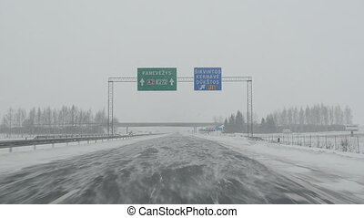 car drive snow blizzard - dangerous driving on highway. snow...