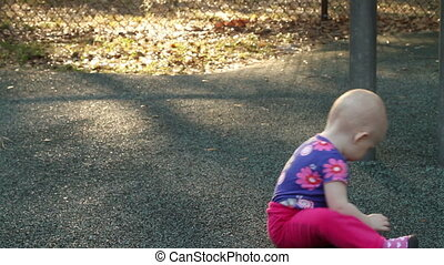 Cute baby girl playing at the park