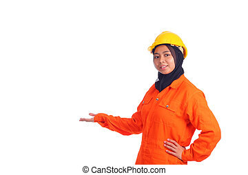 Beautiful young muslim engineer in present text space action. Isolated on white background.