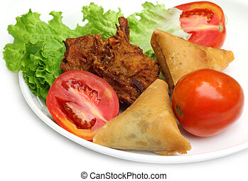 Samosa with mushroom snack with salad items of Indian...