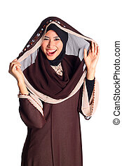 Pretty muslim woman model in action, on white background