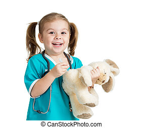 Adorable child with clothes of doctor with hare toy over...