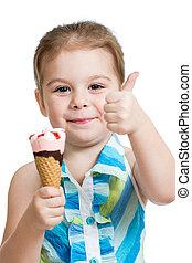 joyful child girl eating ice cream in studio isolated