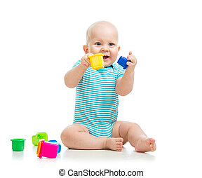 Funny little child is playing with toys isolated over white