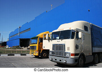 Two powerful lorries at a modern factory
