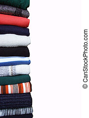 sweaters - Heap of sweaters of clothes on a whiteness
